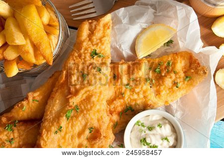 Close Up Of Battered Fish And Chips With Mayonnaise Sauce