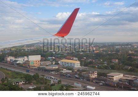 Airplane Flying Over The Nongkhai City , Thailand