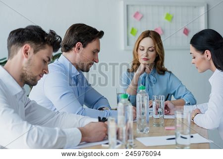 Selective Focus Of Focused Business People At Workplace In Office