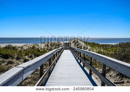 Stairway To The Beach On Jekyll Island Georgia From A Wooden Walkway Over The Sand Dunes