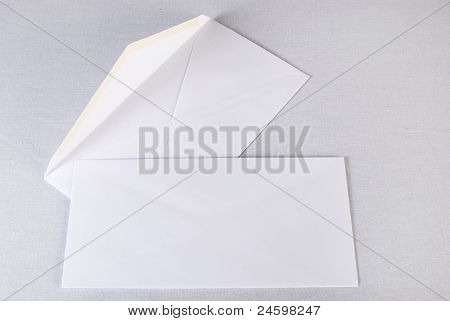 Close Up Of A Two White Envelopes On White Background.