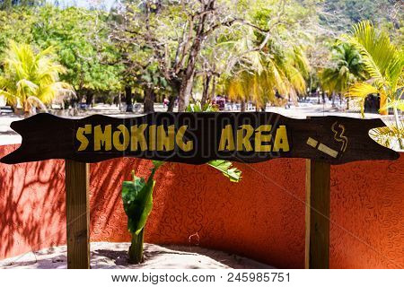 Designated Smoking Area. Smoking Area Sign On A Beach In Labadee, Haiti