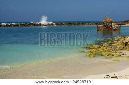 Labadee Island, Haiti. Exotic Wild Tropical Beach With Palm And Coconut Trees Against Blue Sky And A
