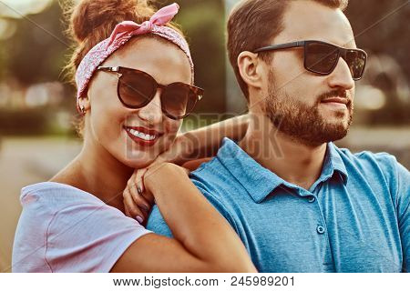 Attractive Couple Enjoying Rest In The Park. Happy Middle Age Couple During Dating Outdoors.