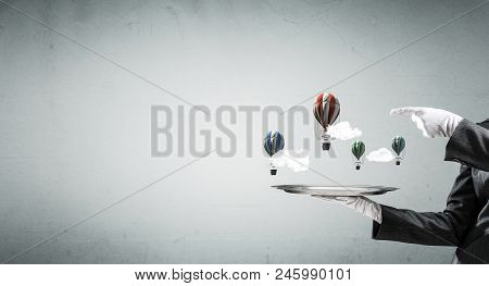 Hand Of Waitress Presenting Balloons On Tray.
