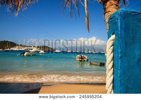 View Of The Idyllic Little Harbor Of Guadalupe, Caribbean Islands. Fishing Boats Floating In The Bac