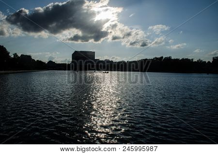 A Large Ostankino Pond, A Huge Gray Cloud, An Urban Landscape, A Pond