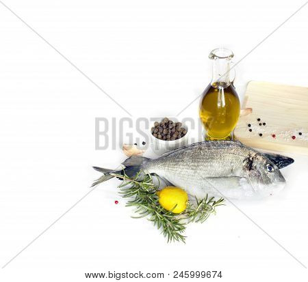 Delicious Fresh Fish Isolated On White Background. Fish With Spices And Vegetables - Healthy Food, D