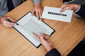 Hand of employer filing final remuneration after employee to write a document letter of resignation, resign concept. poster