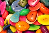 Background of colorful buttons made with vegetable ivory made from the nut of a tropical palm poster