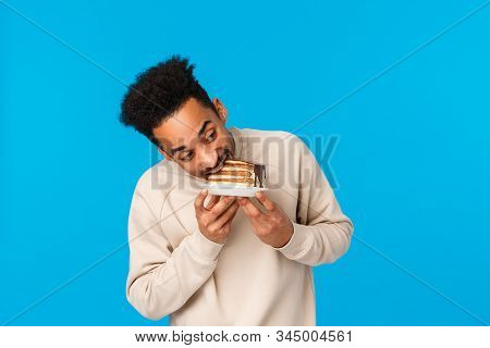 Guy Stole Piece Cake And Eating It Fast. Funny And Cute African-american Man Holding Plate, Bite Del