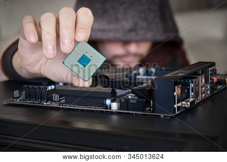 Concept For Hacker In Control Of Personal Data From Computer. Unrecognizable Man Wearing A Hoodie Wh