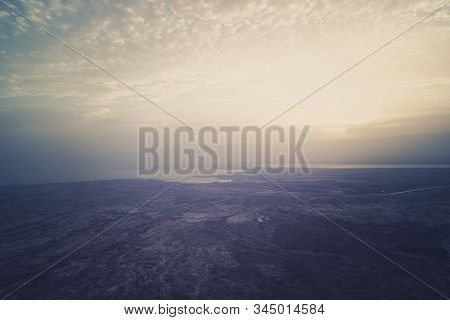 Aerial View Of The Dawn Over The Dead Sea. Beautiful Panorama Of Foggy Israeli Sea And Sea Coast Sho