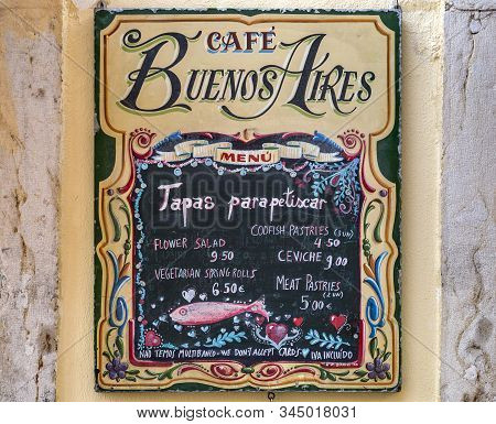 Lisbon - August 26, 2019: View Of The Tapas Menu On The External Wall Of The Cafe Buenos Aires In Th