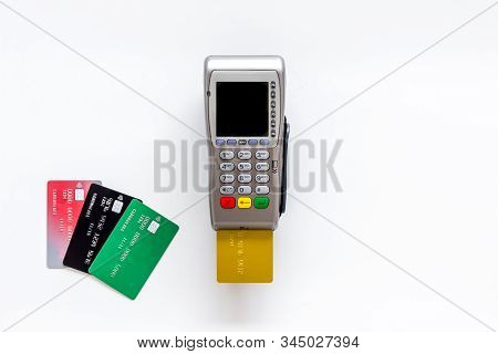 Pay By Credit Card In Shop. Terminal And Card On White Background Top-down Copy Space