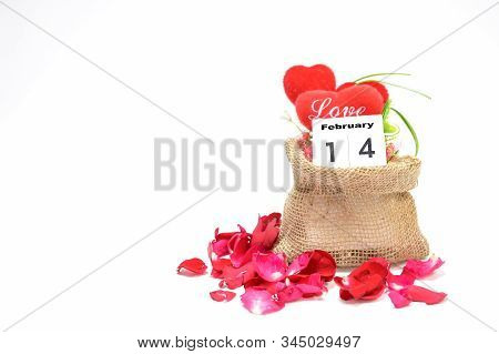 The Red Heart In The Sack Of Love On A White Background