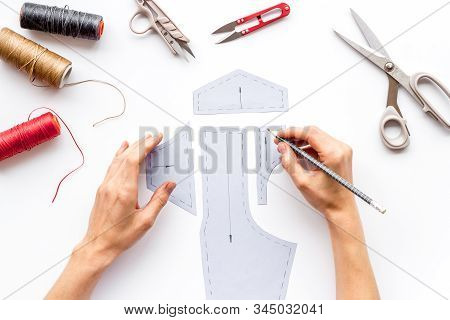 Tailor Working. Women Hands Drawing Patterns For Clothes On White Background Top-down