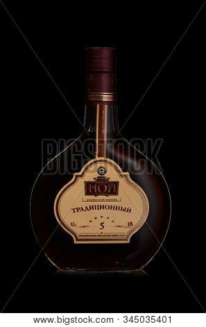 St.Petersburg, Russia - December 2019 - Bottle of NOY traditional Armenian cognac on black background. Five-year aging. Brand of ?Yerevan Ararat Brandy Factory