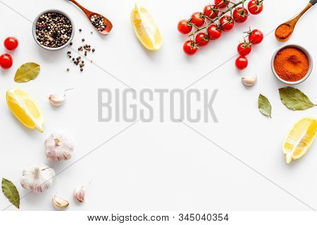 Kitchen Frame With Spices And Food - Pepper, Garlic, Cherry Tomatoes - On White Background Top-down