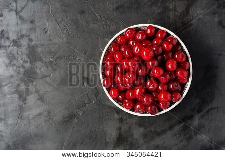 Fresh Cherries In Bowl On Table. Flat Lay Background.