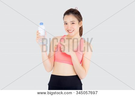 Beautiful Young Asian Woman In Sport After Workout Drinking Water For Thirsty Isolated On White Back