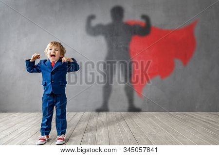 Happy Child Wants To Become A Super Hero. Funny Kid Dreams Of Becoming A Superhero. Imagination And
