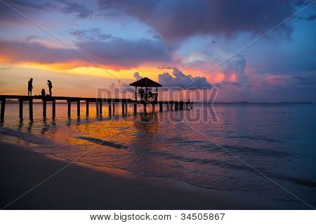 Pavilion on the beach with sunset