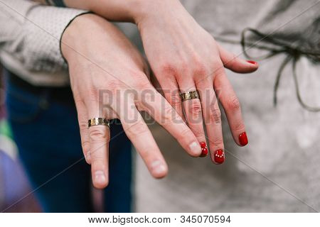 Image Of A Man And Woman With A Wedding Ring. Wedding Day Ceremony. Newlyweds Hands With Wedding Rin