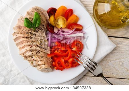 Sliced Chicken Breast Cooked Under Vacuum At Low Temperature. Juicy Chicken Fillet, Fresh Pepper, On