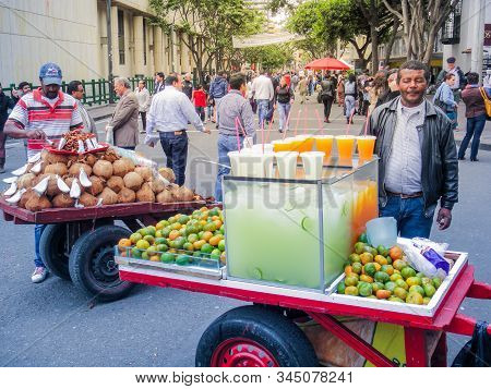 Bogota, Colombia - August 01, 2014: Vendors Selling Fresh Coconuts And Mandarins In The Streets. Str