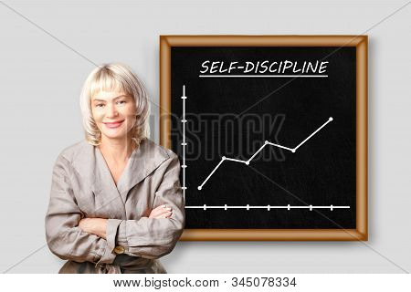 Smiling Woman Standing Near Board With Text, Self Discipline And Growth Chart. Discipline And Self M