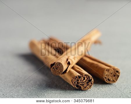 Ceylon Cinnamon Sticks On Gray Stone Background. True Cinnamon Sticks Or Ceylon Cinnamon With Copy S