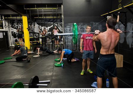 Personal Trainer Giving Fitness Instruction At A Crossfit Group Class