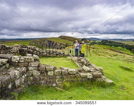 13 August 2018: Hadrians Wall, Northumberland - Group Of Walkers At Turret 45a On Hadrians Wall Near