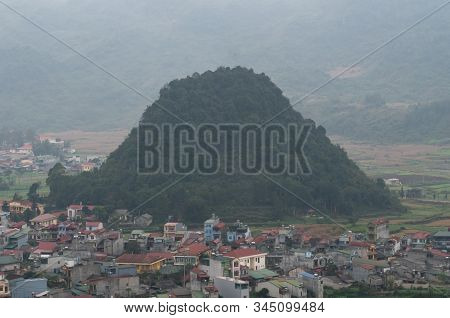 Hazy Day Over Looking Small Picturesque Tom Son Town In Quan Ba Valley, Vietnam