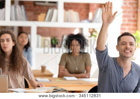 Motivated Male Student Ask Hand Asking Question At Lesson