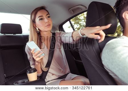 Woman In Car, Taxi In Passenger Seat, Asks To Stop Taxi Driver Destination. In Summer City, Car Shar