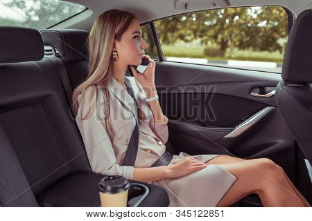 Woman Car, Taxi Passenger Seat, Calls Smartphone, Listens Voice Message. In Summer City, Car Sharing