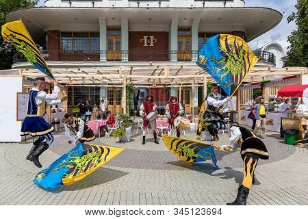 Moscow, Russia, July 13, 2019: Bright Street Show Of Italian Flag-bearers In Renaissance Costumes