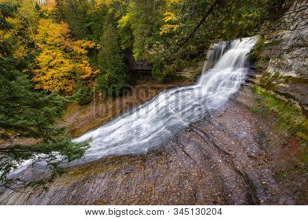 Autumn Michigan Waterfall. Laughing Whitefish Falls Scenic Site Surrounded By Fall Foliage In The Up