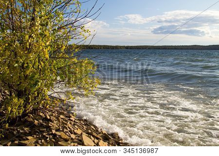 Shores Of Lake Superior. Waves Crash On A Rocky Lake Superior Beach On A Warm Fall Day In The Upper