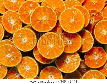 Fresh Chopped Orange Slices Food Background, Fresh Orange Color For Use In Making The Background, Or