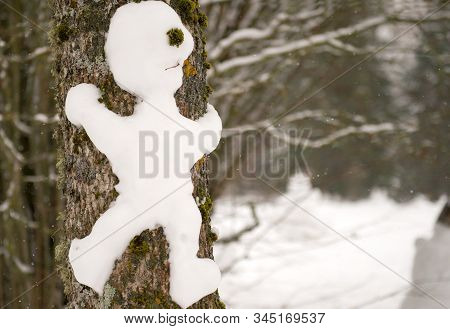 Cute Smiling Snowman With A Funny Haircut Is Standing In The Snow Winter Forest. Little Snownam Made