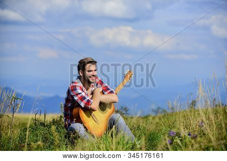 Music For Life. Country Music Song. Sexy Man With Guitar In Checkered Shirt. Hipster Fashion. Happy
