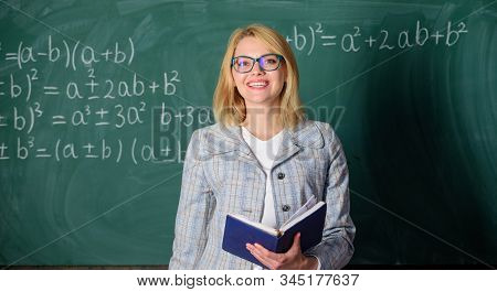 Effective teaching involve prioritizing knowledge and skills. Effective teaching involve acquiring relevant knowledge. Woman teaching near chalkboard in classroom. Qualities that make good teacher poster