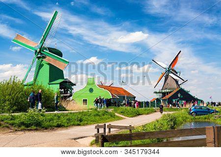 Zaandam, Zaanse Schans, The Netherlands - May, 2018: Zaanse Schans Village With Tourists Near Zaanda