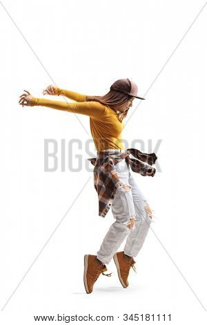 Young woman dancing on tiptoes isolated on white background