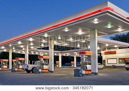 Horizontal Shot Of A Retail Gasoline Station And Convenience Store At Dusk.