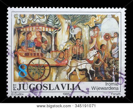 ZAGREB, CROATIA - JUNE 21, 2014: A stamp issued in Yugoslavia shows Royal Procession by Iromie Wijewardena,     Paintings in the Josip Broz Gallery, circa 1985.