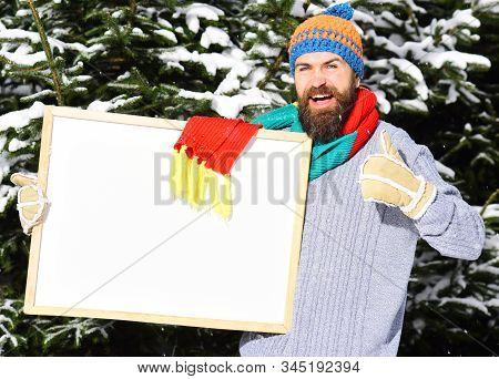 Guy Shows Thumb Up With Firtrees Covered With Snow.